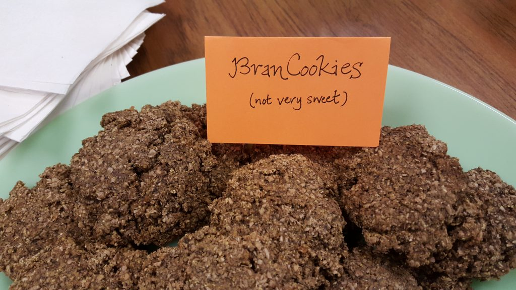 "WWI-style Bran Cookies with sign that reads ""not very sweet"""