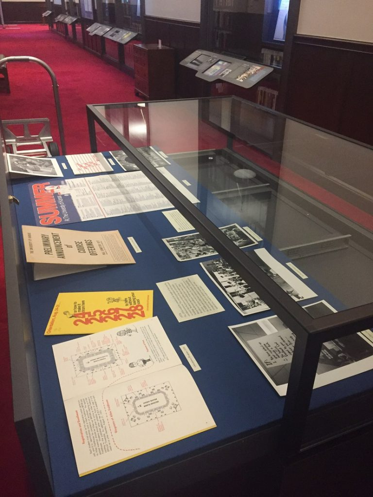 Photograph of the enrollment exhibit being installed
