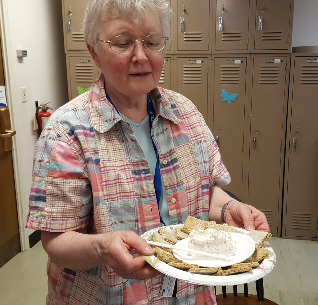 Karen Severud Cook with her oat crackers with goat cheese