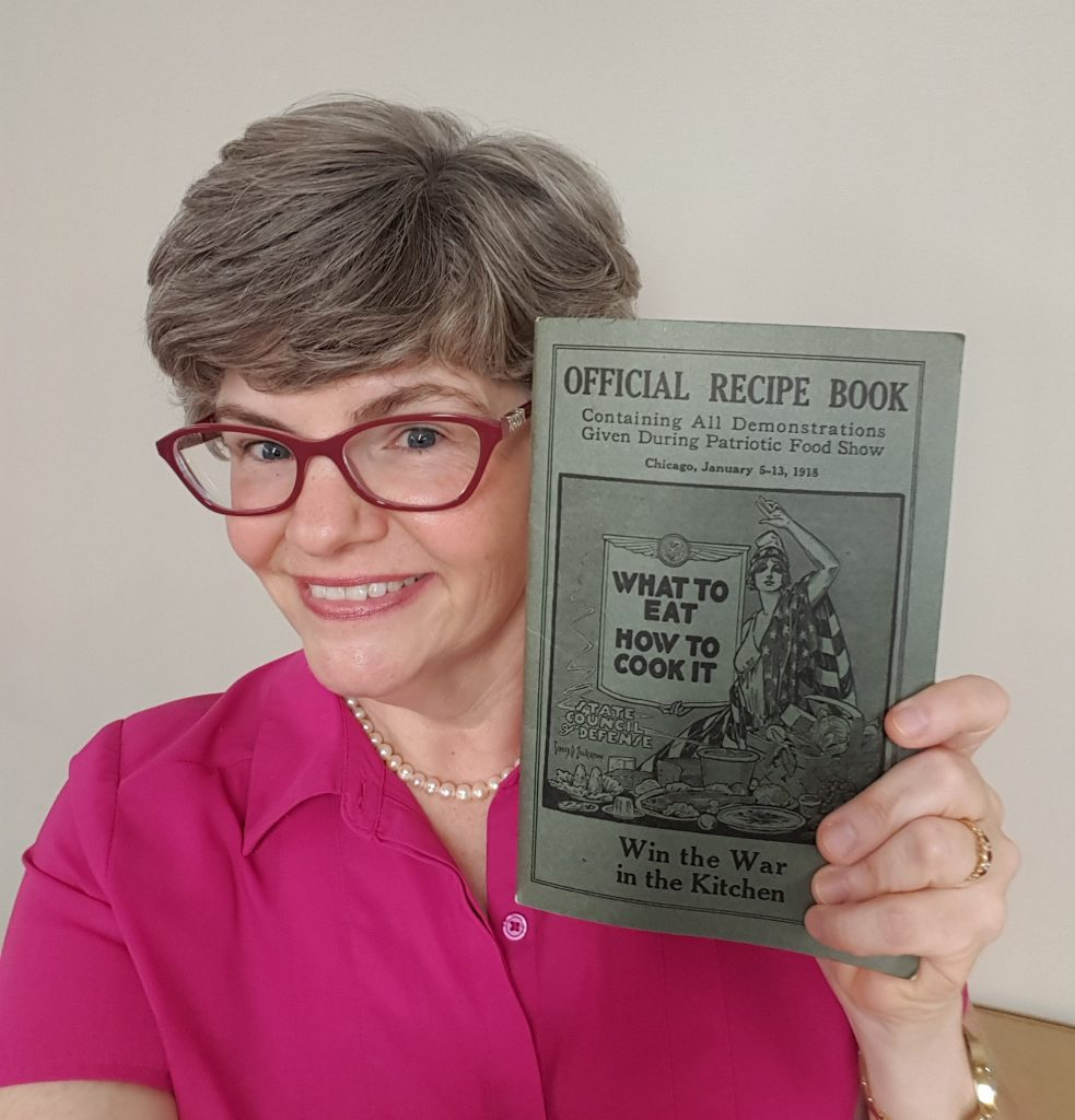 Lynn Ward with WWI recipe book.