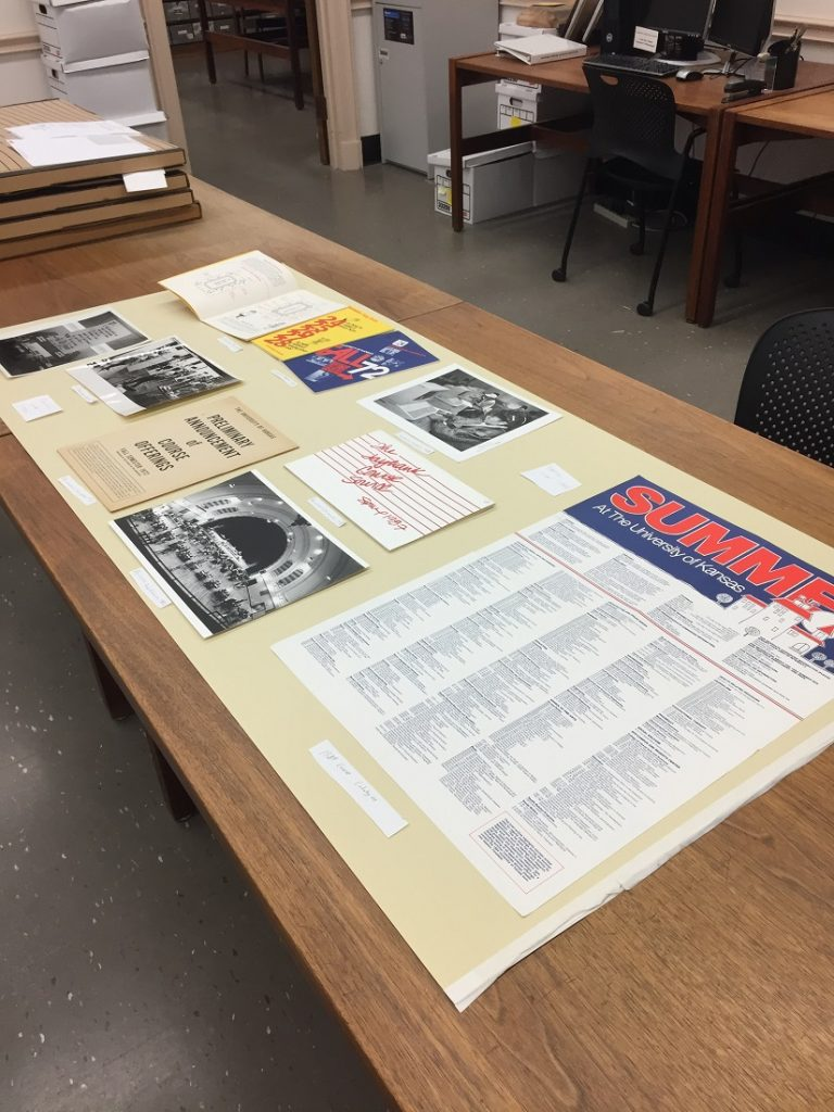 Photograph of a temporary exhibit being developed for University Archives