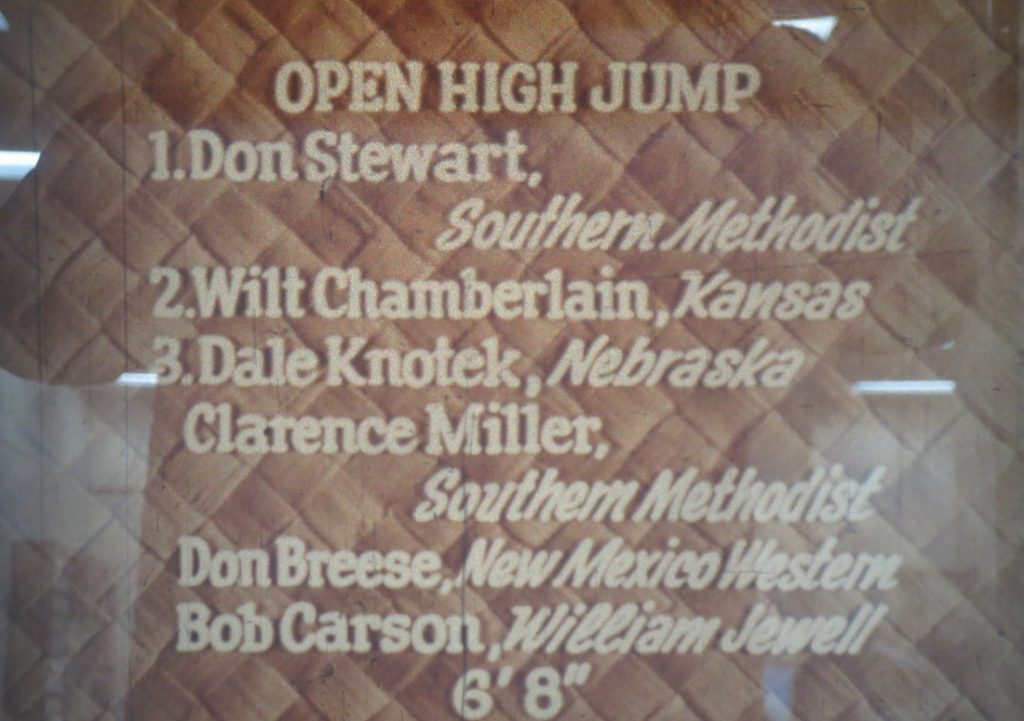 Film still of the high jump standings at the Kansas Relays, 1957