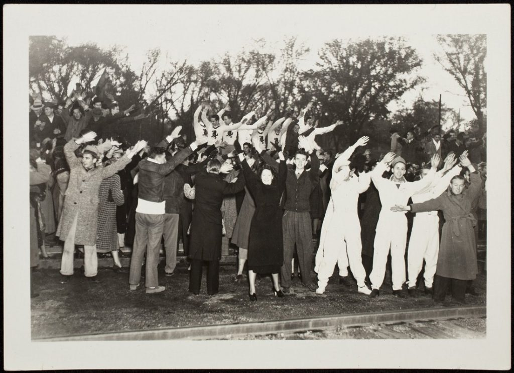 Photograph of football fans at a pep rally, 1936-1937