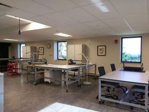 Height-adjustable, wheeled workbenches and tables in the new lab space.