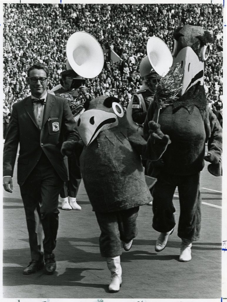 Photograph of KU Chancellor Chalmers with new Baby Jay at Homecoming, 1971