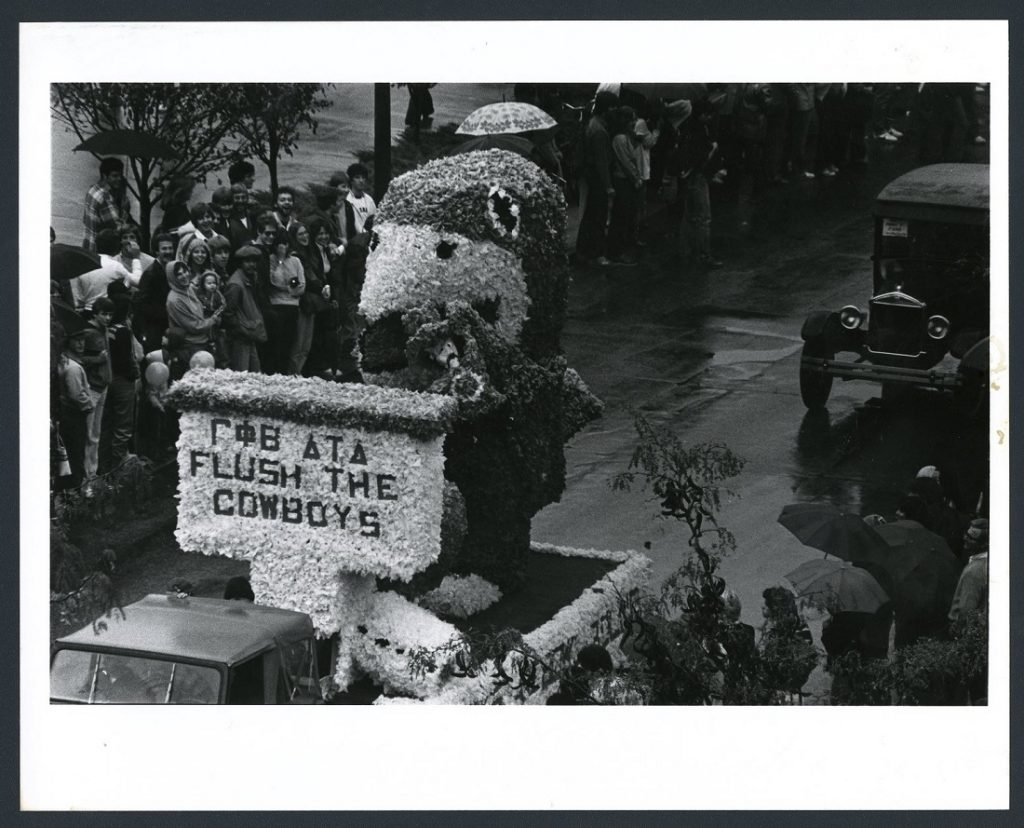 "Photograph of the ""Flush the Cowboys"" float in the Homecoming parade, 1979"