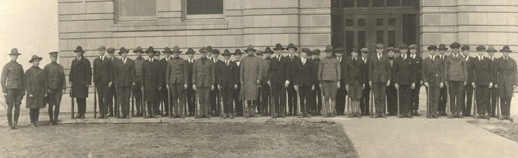 Photograph of members of KU's S.A.T.C. in front of Strong Hall, 1918