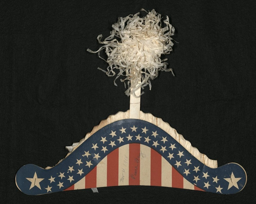Image of the paper hat worn by Eva Lathrop Phillips on Armistice Day, November 11, 1918