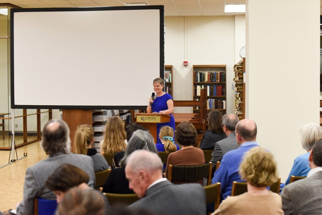 Photograph of Beth M. Whittaker speaking at Spencer Research Library's fiftieth anniversary celebration, 2018
