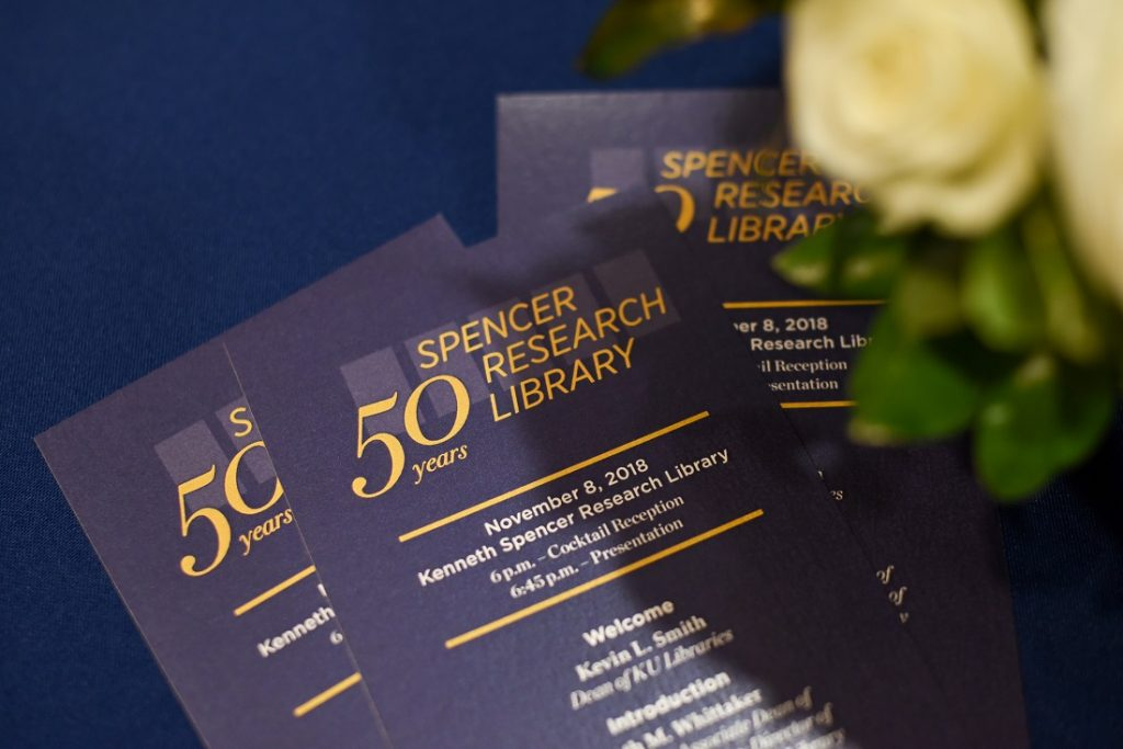 Photograph of event programs at Spencer Research Library's fiftieth anniversary celebration, 2018