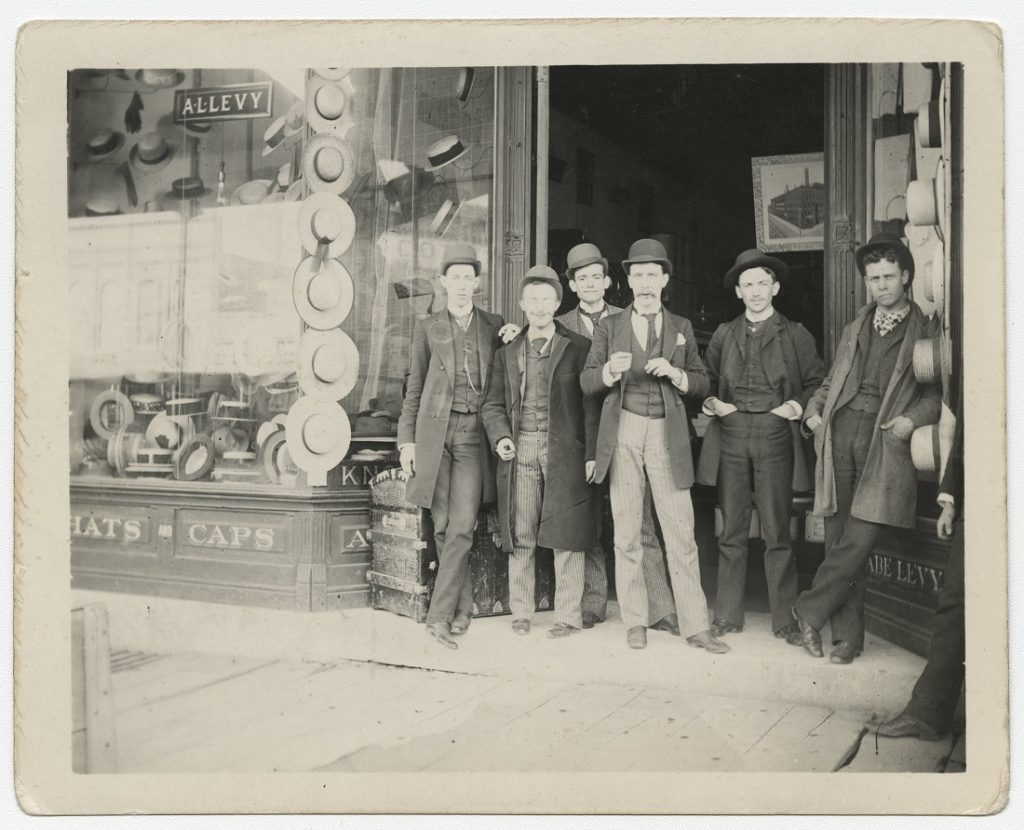 Photograph of KU students in front of Abe Levy's clothing store, 1890s