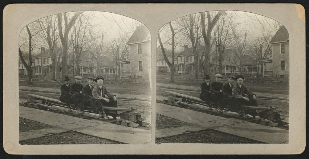 Photograph of KU students on a makeshift bobsled, 1912