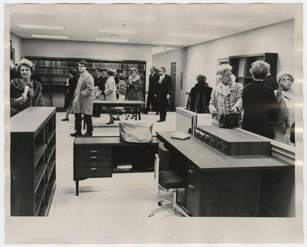 Photograph of guests touring the Special Collections reception area after the dedication of Kenneth Spencer Research Library, November 8, 1968
