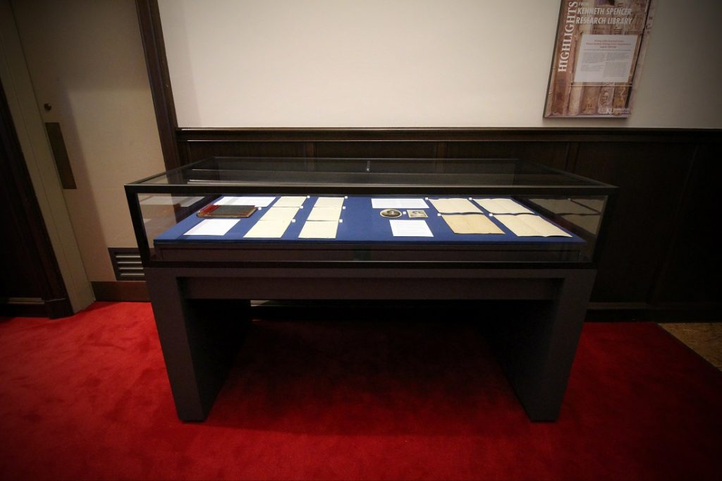 Photograph of the temporary exhibit case on the east side of Spencer Research Library's North Gallery