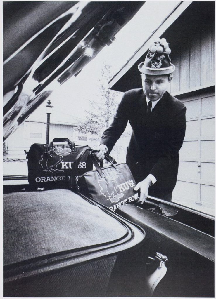 Photograph of a man in a KU Orange Bowl hat, 1968