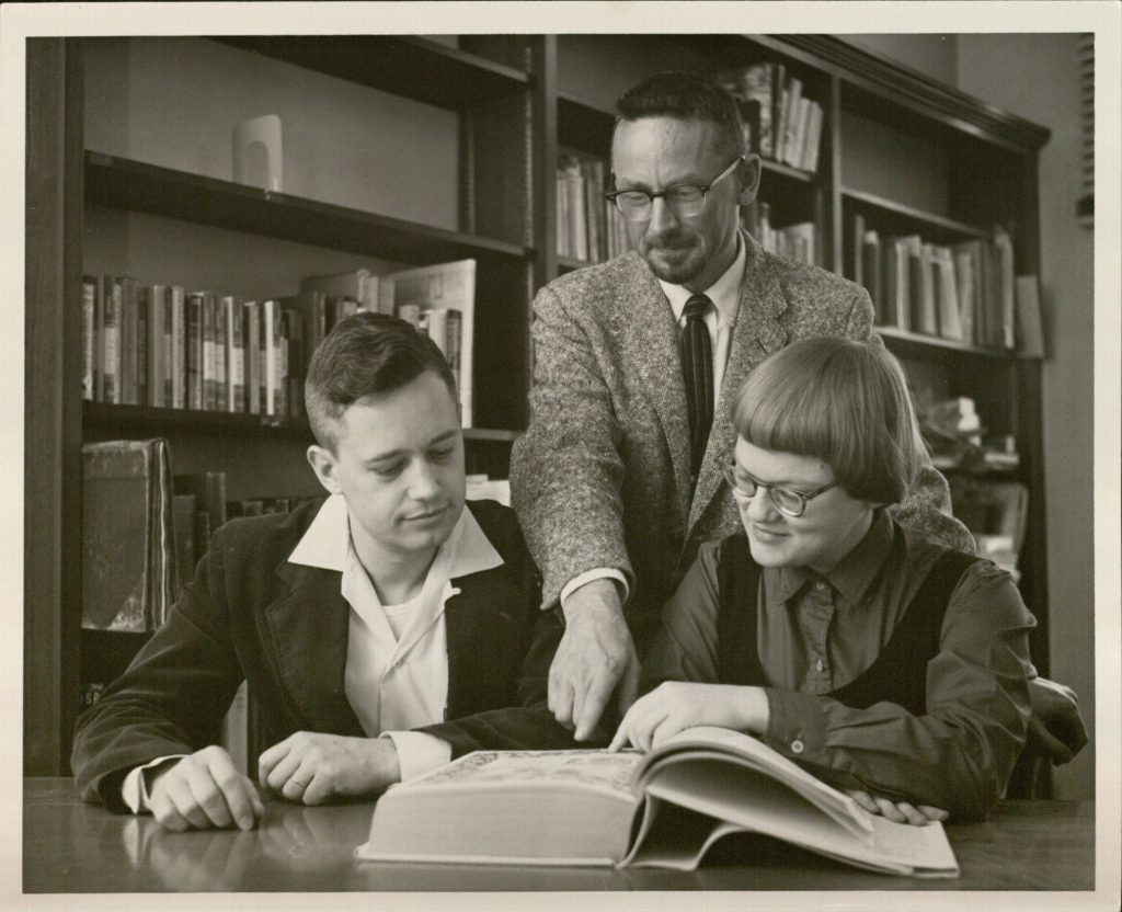 Ann Hyde (1960 Emily Taylor Book Collecting Contest winner), with second place winner E. Bruce Holmes (left), and KU libraries Assistant Director, Robert L. Quinsey (center)