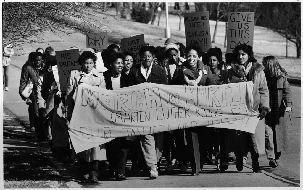 Photograph of a Martin Luther King, Jr. march at KU, 1982