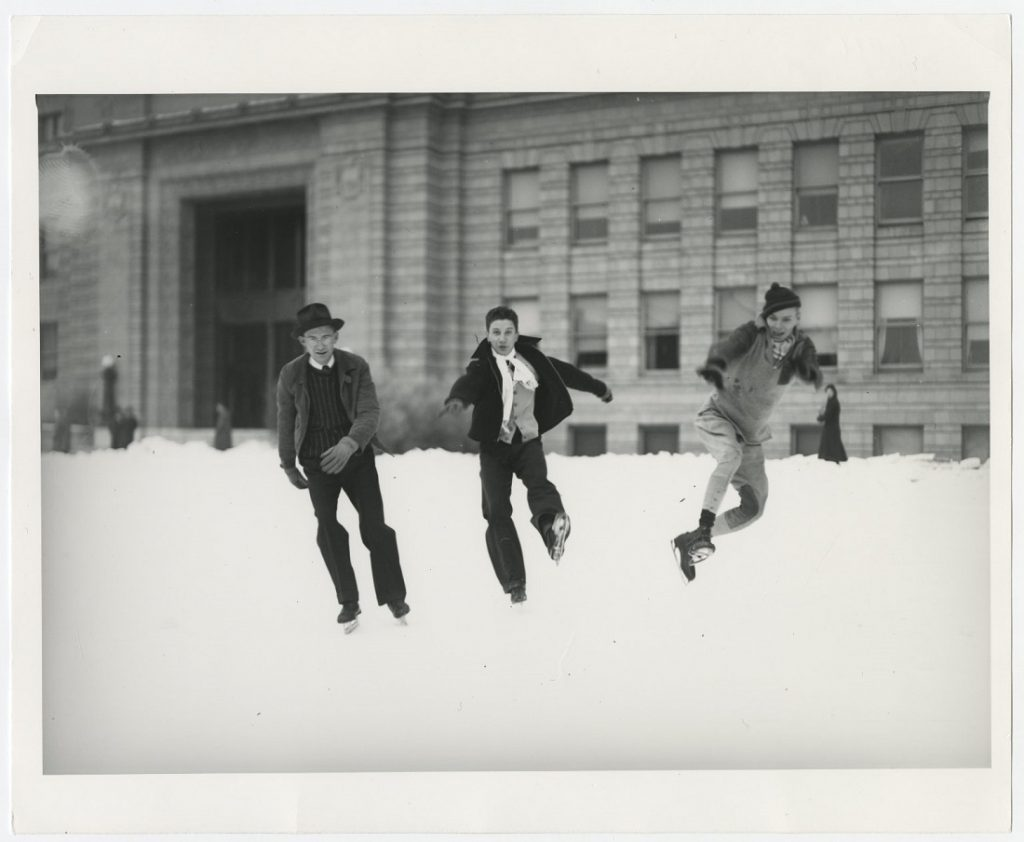 Photograph of KU students ice skating in front of Strong Hall, 1936-1937