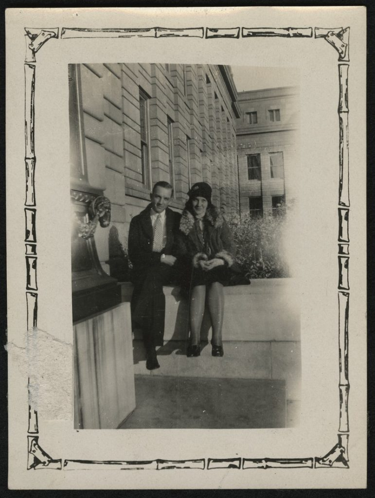 Photograph of two KU students sitting on the Strong Hall steps, 1925