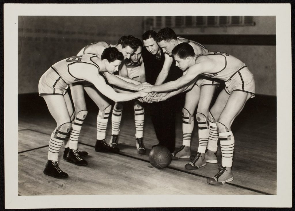 Photograph of Phog Allen with the KU men's basketball team, 1935-1936
