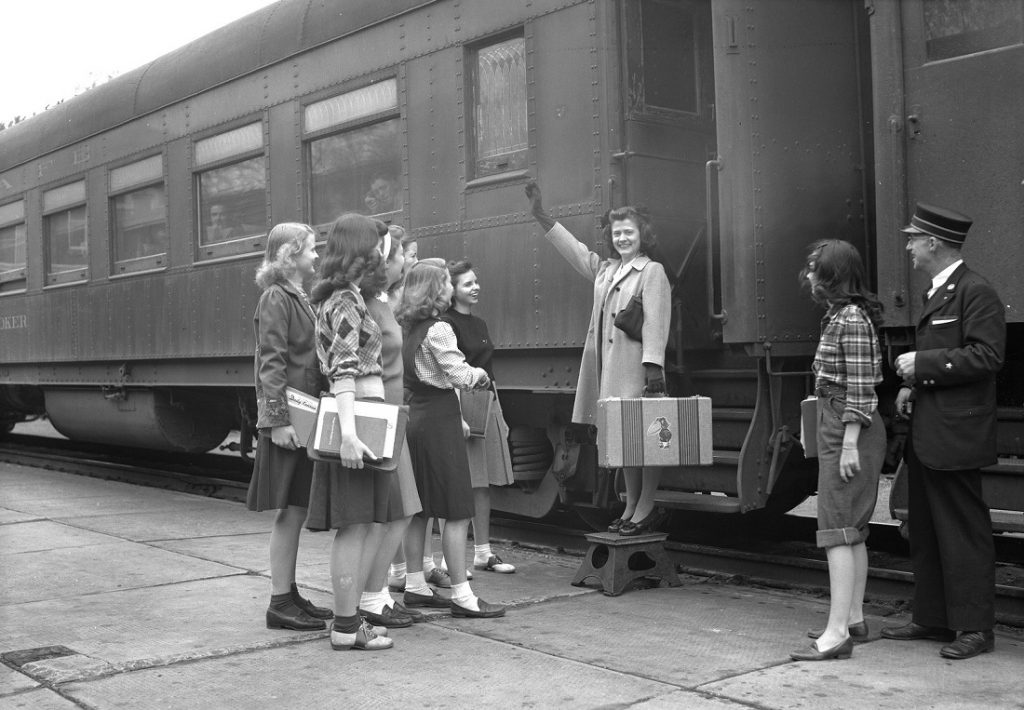 Photograph of a KU student boarding a train, 1944-1945