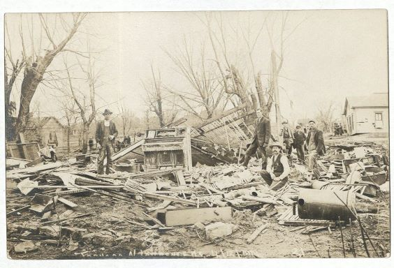 Photograph of the ruins of an unidentified home after the tornado, April 13, 1911