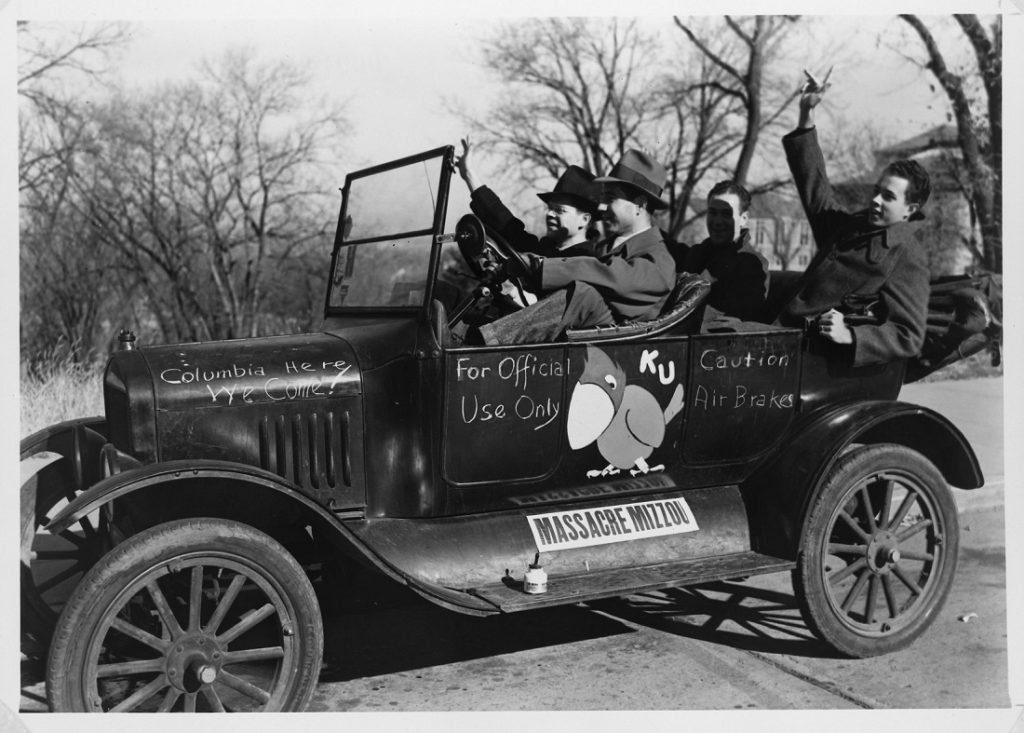 Photograph of KU football fans in a decorated car, 1940