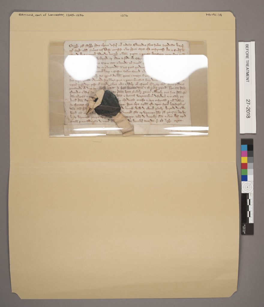 Abbey Dore manuscript with seal before rehousing. MS Q80: 14.