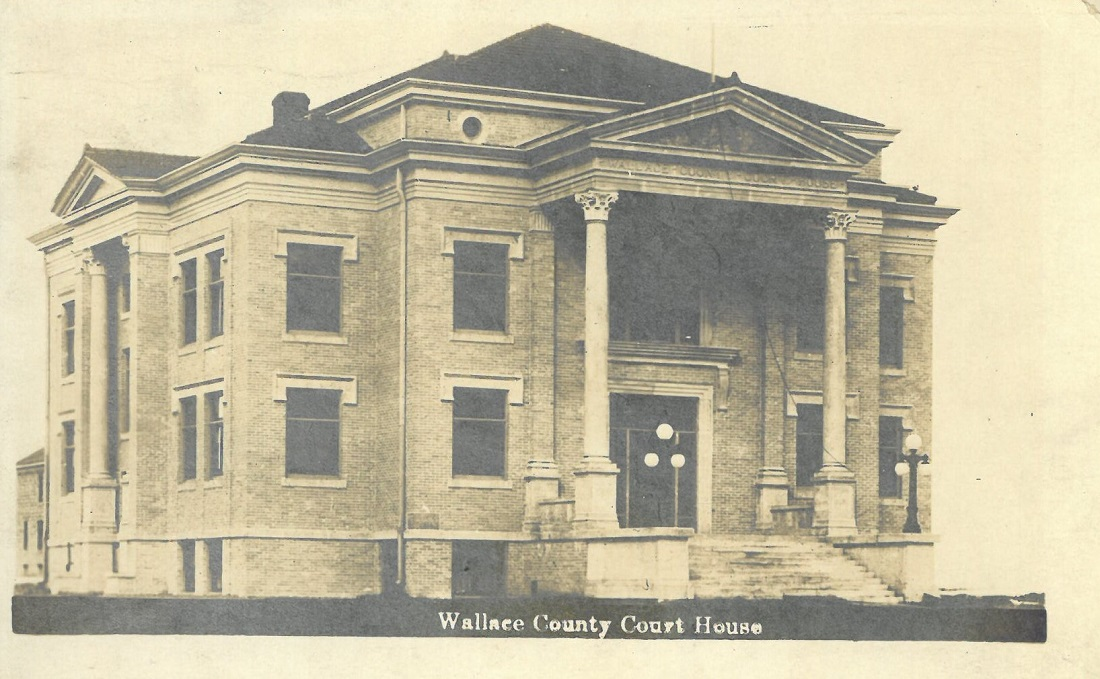 A real photographic postcard of the Wallace County Courthouse in Sharon Springs, Kansas