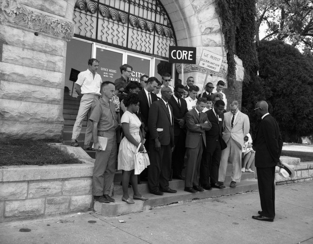 Photograph of a CORE group in front of Lawrence City Hall, 1964