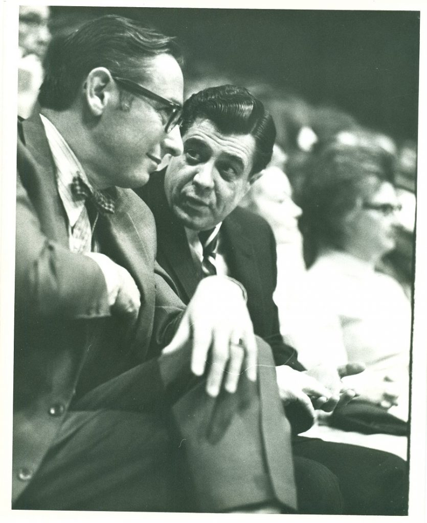 Photograph of Kansas Governor Robert Docking with KU Chancellor E. Laurence Chalmers at a basketball game, circa 1969-1972
