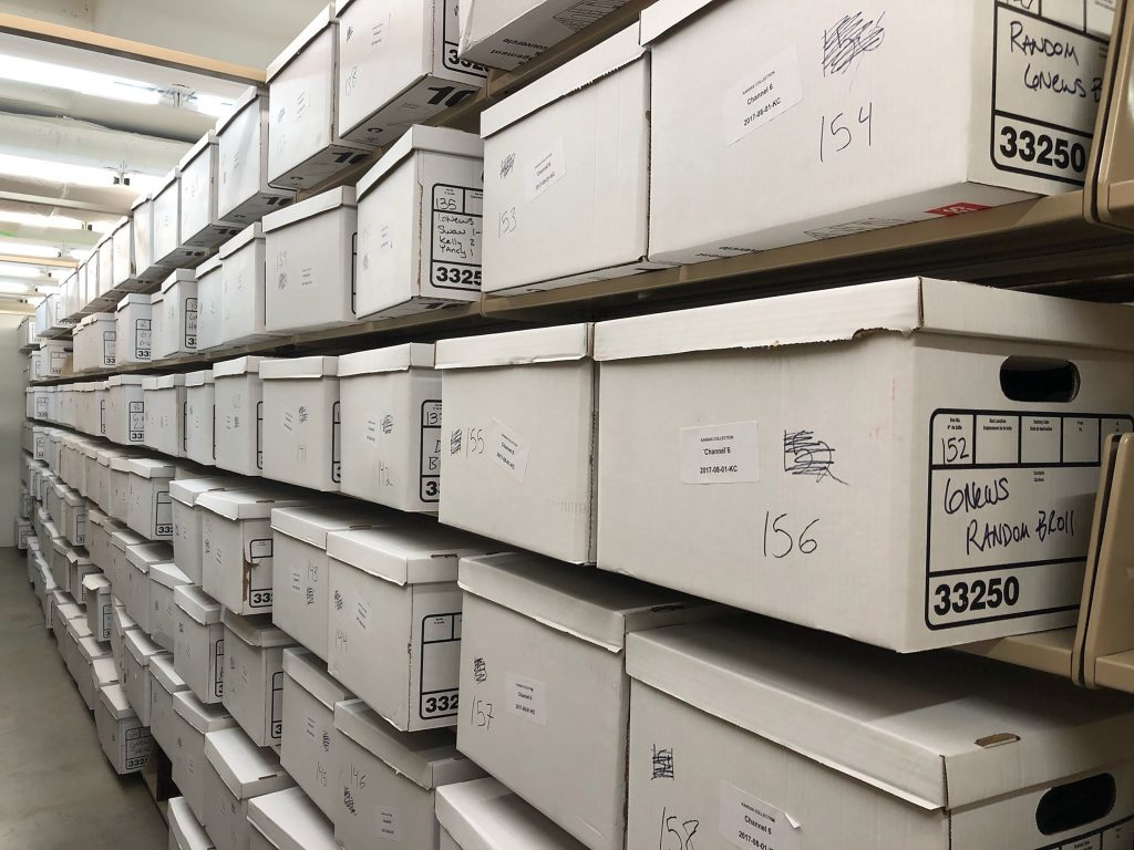 Boxes containing video tapes and other material from the Channel 6 collection acquired by Spencer Research Library in 2018.