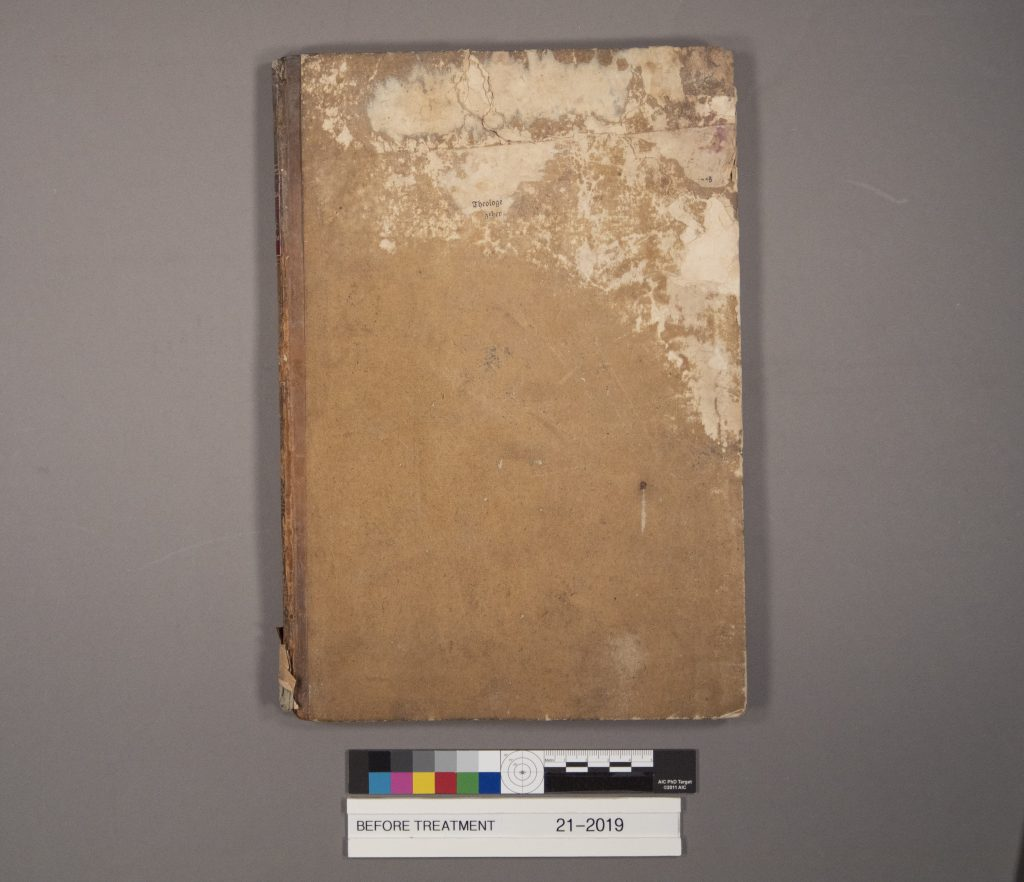 Damaged cover of MS E279, Historia flagellantium..., prior to conservation treatment.