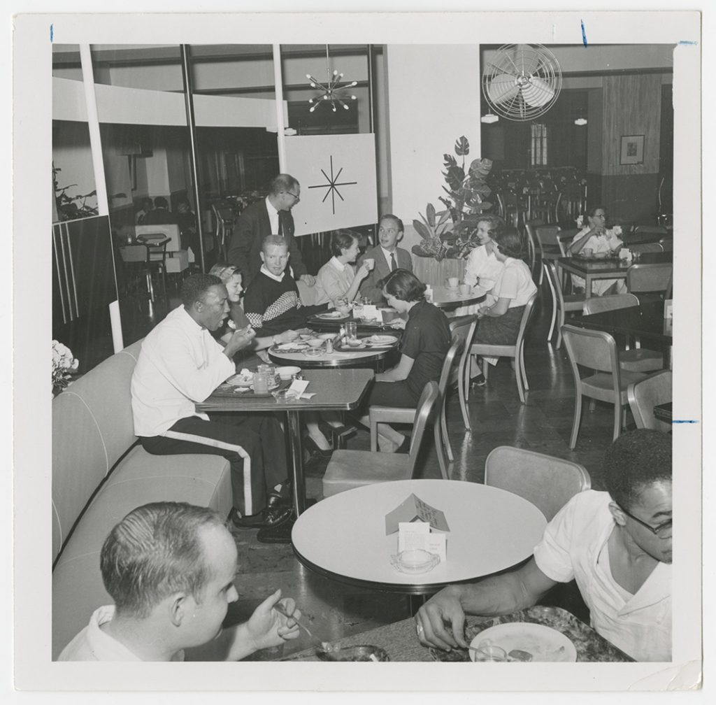 Photograph of KU students in the cafeteria at the Memorial Union, 1956-1957
