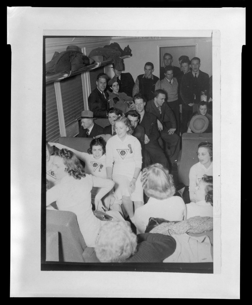 Photograph of KU football fans on a train headed for Lincoln, Nebraska, 1939-1940