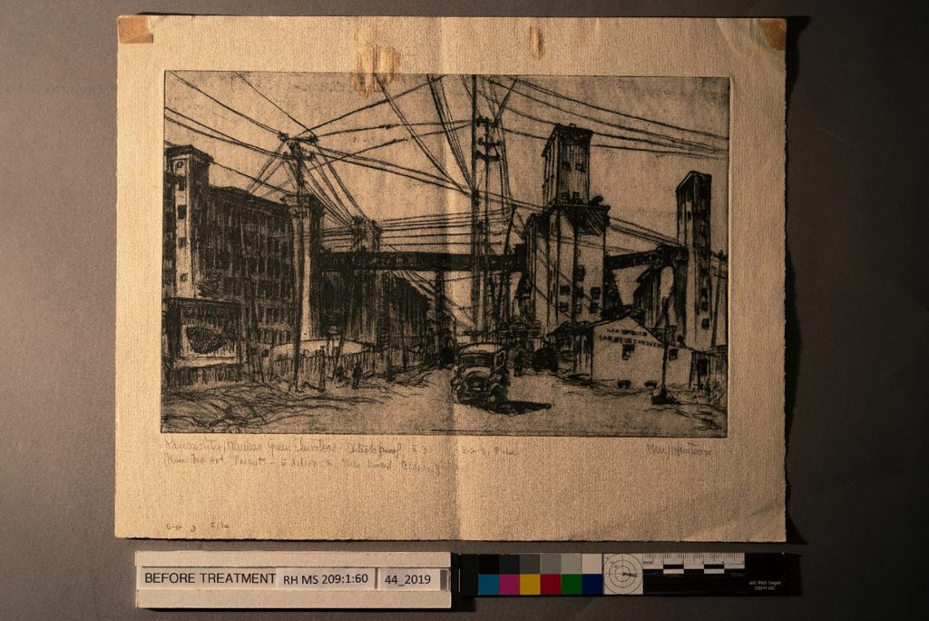 "The Mary Huntoon print, ""Kansas City, Kansas Grain Elevators,"" in raking light, prior to treatment."