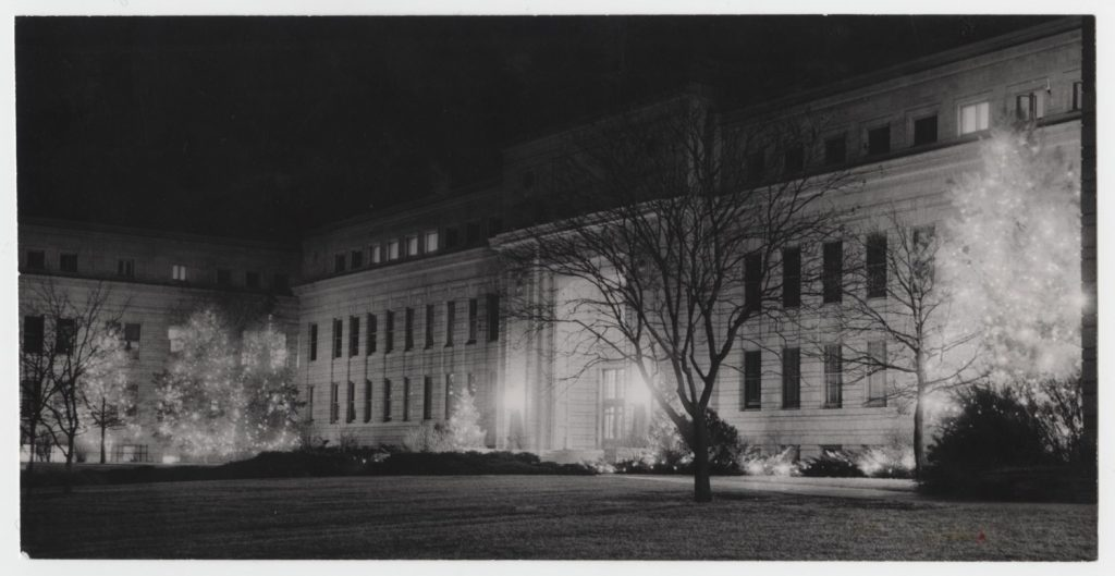 Photograph of Strong Hall with holiday lights, 1952