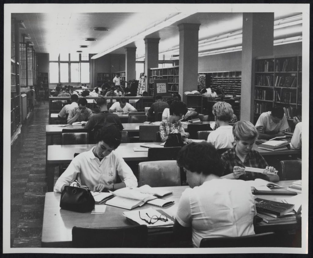 Photograph of KU students working in the Undergraduate Reading Room at Watson Library, 1962