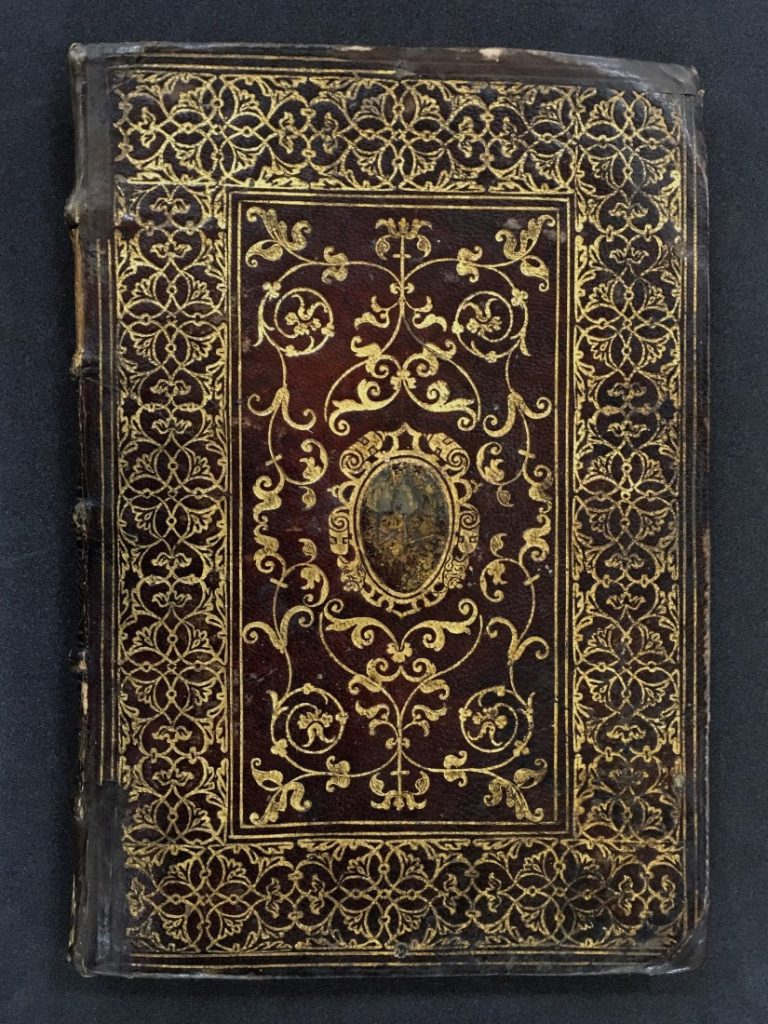 Photograph of the binding of MS C247, featuring the shield of Dominicus Capranica
