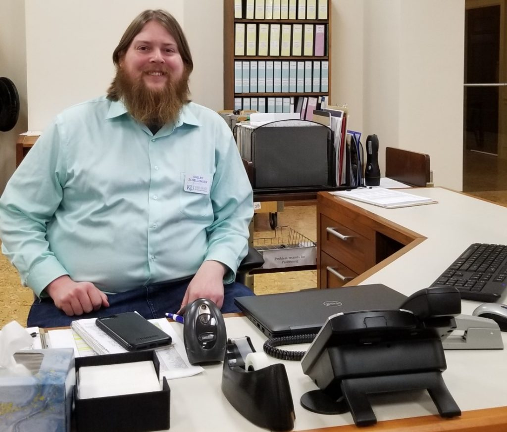 Photograph of Shelby Schellenger at Spencer's reference desk