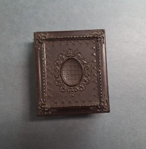 Exterior of a photograph case containing a Valentine poem.