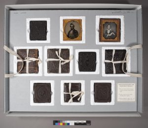 Upper tray of housing for cased photographs from the Frowe and Lathrop Families Records.
