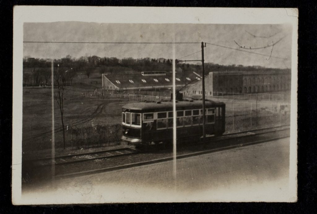 Photograph of a streetcar passing in front of Memorial Stadium, 1925-1926