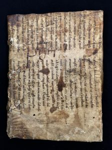 Front cover of MS C189 showing re-use of a manuscript bifolium