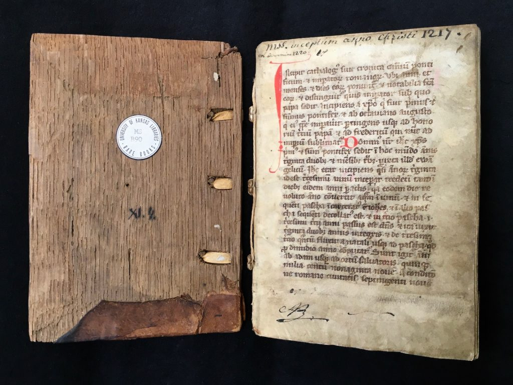 Image of Front Cover (wooden board) and folio 1 recto of Spencer Research Library manuscript MS B90.