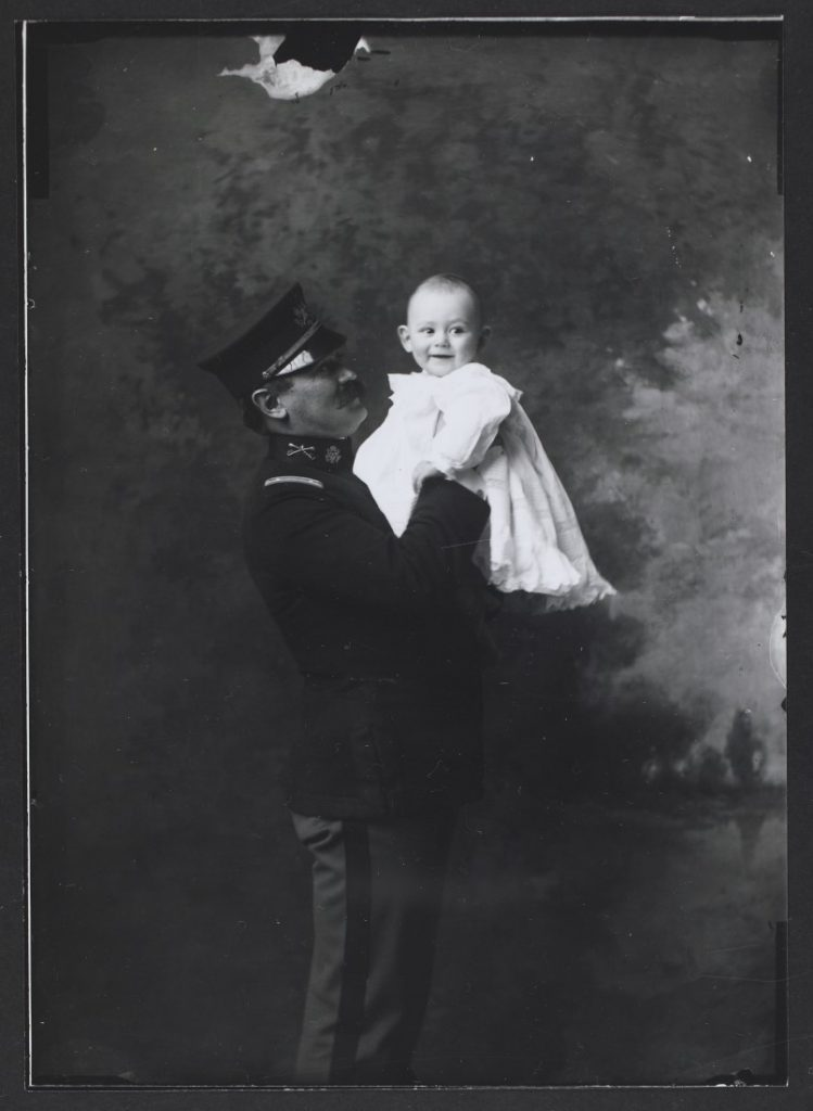Photograph of Lieutenant Dorsey with his baby, 1902