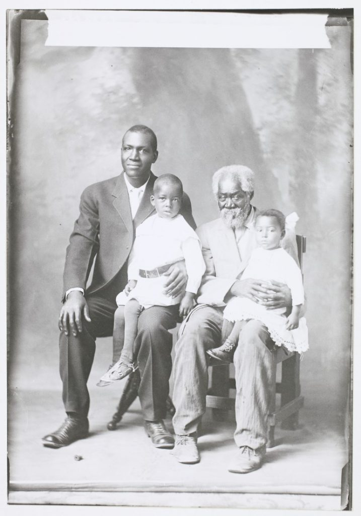 Photograph of Alex Johnson with members of his family, 1913