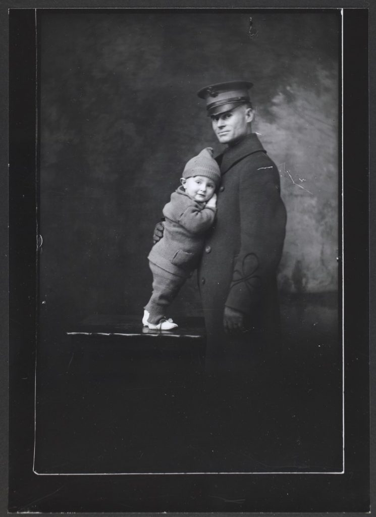 Photograph of Lieutenant R.L. Cox with his baby, 1920-1921