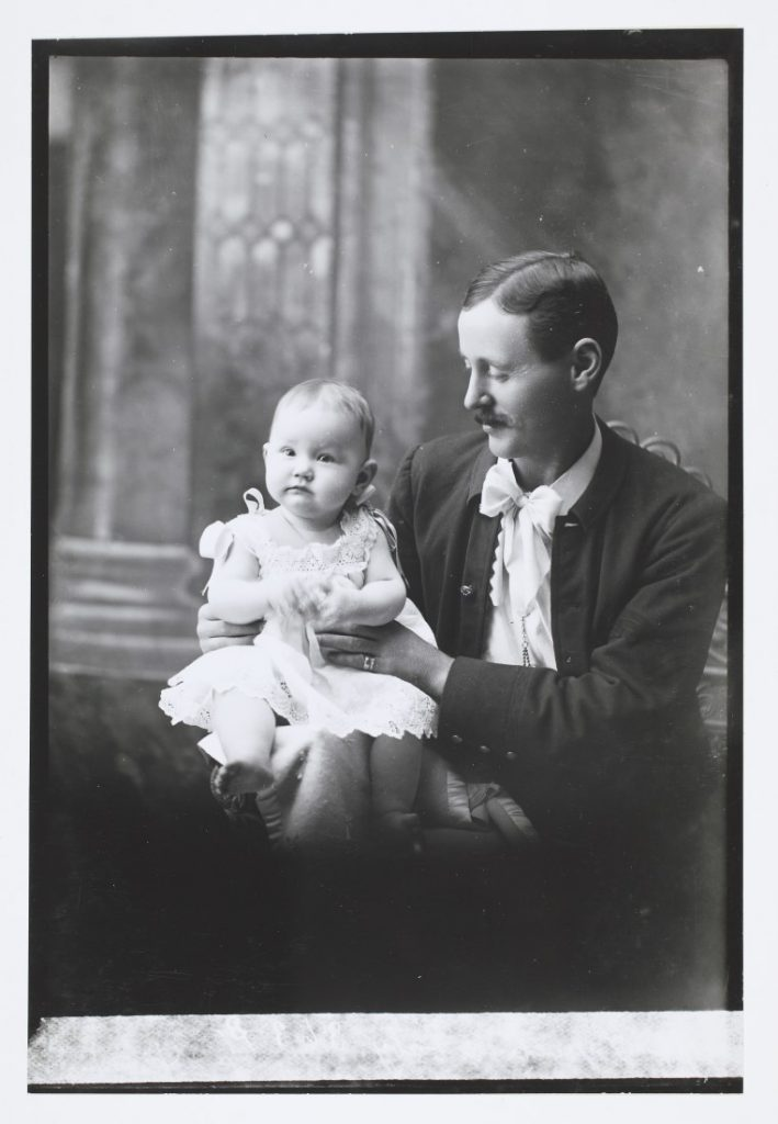 Photograph of Sgt. Lynch with his baby, 1898