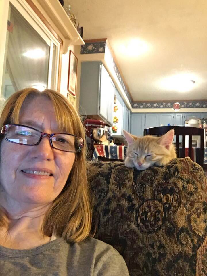 Photograph of Kathy and her cat Buzz